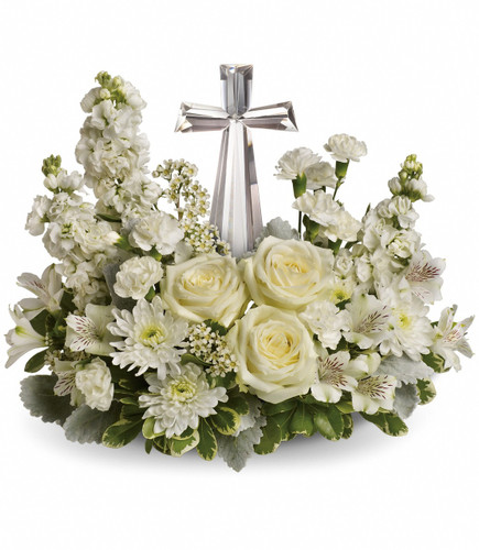 Divine Peace Crystal Cross Sympathy Flowers by Enchanted Florist Pasadena TX. All white roses and other flowers in a sympathy container with a clear cross for the family to keep. Sympathy flowers delivered in Houston TX and surrounding areas. RM528