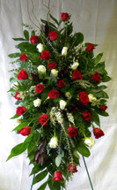 Devoted Love Red Rose Funeral Flowers by Enchanted Florist Pasadena TX. Daily delivery to most Houston TX area funeral homes. White Rose and Red Rose funeral flowers delivered the same day in this beautiul standing spray. RM525