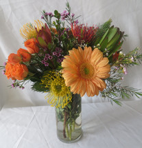 Peaches and Creme Gerbera Rose Bouquet by Enchanted Florist Pasadena TX is a beautiful soft bouquet  Orange gerberas and tropical proteas with orange spray roses hand delivered today by a real florist in Houston TX, Deer Park TX, Webster TX and surrounding areas. RM157