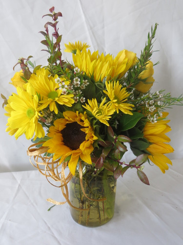 Sunnyside Sunflowers in Mason Jar by Enchanted Florist Pasadena TX. Sunflowers and yellow daisies in a yellow mason jar for same day delivery in Houston TX and surrounding areas. RM155