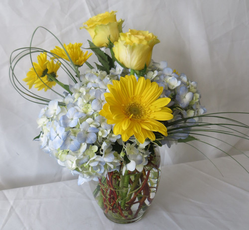 Dew Drops Blue Hydrangea and Yellow Rose Bouquet by Enchanted Florist Pasadena TX. A simple yellow and blue bouquet for same day delivery in Houston TX, Pasadena TX, Deer Park, TX, Webster TX and surrounding areas. RM156