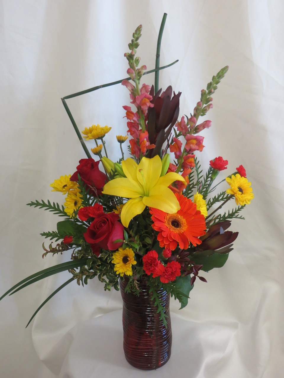 Romantic Red And Yellow Flowers In Red Vase By Enchanted Florist