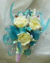 Turquoise Iridescent Trim and White Rose Prom Flower Corsage by Enchanted Florist Pasadena TX.  Buy prom flowers online in Pasadena TX for most Pasadena schools including Memorial, Pasadena, South Houston, Deer Park, Dobie, La Porte, Sam Rayburn.  PROM103