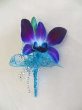 Blue Orchid Boutonniere Prom Flowers by Enchanted Florist Pasadena TX.  Prom flowers for the big night in Pasadena TX.