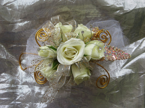 Gold Corsage for Prom with White Roses. Prom Flowers by Enchanted Florist Pasadena TX. Prom flowers in Pasadena TX for local high schools. PROM106