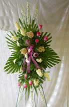 Heavenly Memories Funeral Standing Spray by Enchanted Florist Pasadena TX. Premium flowers of fragrant yellow stock, white mini calla lilies, hot pink roses and tropical protea flowers arranged by our expert flower designers to create this heavenly display of beautiful funeral flowers.  Houston funeral flowers Pasadena TX funeral flowers. RM521