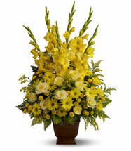 Sunny Yellow Memories Sympathy Flowers by Enchanted Florist Pasadena TX. All yellow funeral flower arrangement of bright sunny flowers including yellow gladiolas, yellow roses, yellow daisies and in a brown funeral urn. RM530