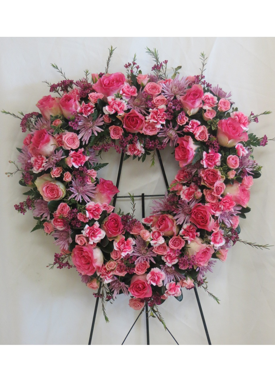 Pink Roses, pink and lavender flowers in heart shape funeral spray