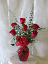 Deluxe Half Dozen Red Roses by Enchanted Florist Pasadena TX.  6 premium red Ecuadorian roses in a n upgraded red vase with upgraded tropical foliages. Send red roses in Pasadena TX. RM354