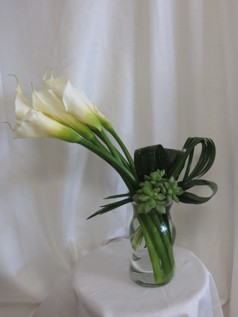Exotic and unique calla lily and succulent bouquet same day pure elegance succulent and calla lily bouquet by enchanted florist tx classic white calla lilies izmirmasajfo