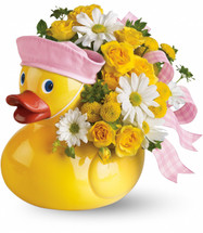Ducky Delight New Baby Girl Flowers by Enchanted Florist Pasadena TX. This adorable yellow ducky is iconic among new baby decor. A yellow ceramic duck with matching pink hat for a new baby girl is complete with precious white daisies, yellow spray roses and yellow button mums.  SKU RM 303