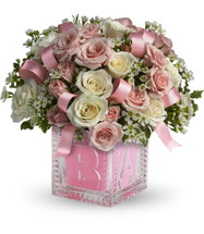 Crystal Block New Baby Girl Flowers by Enchanted Florist Pasadena TX. Send new baby girl flowers in the adorable keepsake crystal block. Includes miniature white and pink spray roses and ribbons tucked in. Simply stunning! RM177