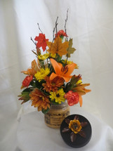 Fall Delight Flower Bouquet and Candle by Enchanted Florist Pasadena TX. Beautiful fall flowers with a candle make the perfect gift for friends and family this season. RM204
