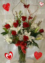Red Roses and White Lilies Valentines Day Flowers by Enchanted Florist Pasadena TX. Red roses and white lilies in a clear vase with curly willow and red butterfly. Same day Valentine flowers in Houston, Pasadena, Deer Park, Webster and Clear Lake Texas.  RM901