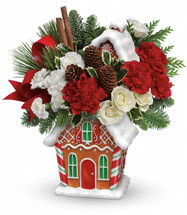 "Home, sweet home! This jolly gingerbread house can't wait to house your Christmas cookies - but first it delivers a fabulously festive bouquet of white roses, red carnations and fragrant evergreens!  White spray roses, red carnations and white miniature carnations are accented with flat cedar, variegated holly, noble fir and white pine. Delivered in a Gingerbread Cookie Jar. Approximately 15 1/2"" W x 16 1/2"" H"