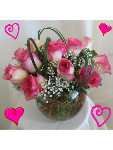 "Love Bowl of Pink Roses for Valentine's Day by Enchanted Florist Pasadena TX. One dozen pretty variegated hot pink tipped creme roses designed by our talented design team in this 8"" clear glass rose bowl and accented with tropical foliages and baby's breath. RM904"