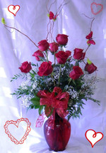 Fire and Ice Premium Dozen Red Roses for Valentines Day from Enchanted Florist. When you want to send the VERY best! Our top selling bouquet, romance is fire and ice- hot and cold. Our beautiful long stem roses from Ecuador are hand delivered in an upgraded red vase using premium foliages, curly willow, and topped off with two dancing butterflies. RM905