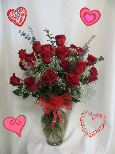 Red Two Dozen Roses for Valentines Day with baby's breath by Enchanted Florist Pasadena TX. This show stopping bouquets of our lush and romantic red roses comes complete with baby's breath, greens and a bow and is hand arranged by our premier floral designers. RM908