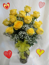Our beautiful and bright yellow two dozen roses for Valentines Day with babys breath by Enchanted Florist Pasadena. This show stopping bouquets of our lush and romantic yellow roses comes complete with baby's breath, greens and a bow and is hand arranged by our premier floral designers.  RM911