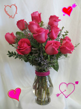 Hot Pink Dozen Roses for Valentines Day from Enchanted Florist Pasadena TX.Then send her one dozen HOT PINK roses.  Our bright hot pink roses are arranged beautifully in vase with babys breath and greenery. RM916