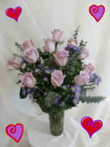 Lovely Lavender Dozen Roses for Valentines Day by Enchanted Florist Pasadena TX - For the purple lover in your life, we bring you a lovely dozen lavender roses complete with purple novi belgi and eucalyptus in a vase. Send a lovely lavender bouquet of roses and delight her senses. RM920