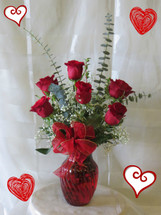 Deluxe Half Dozen Red Roses by Enchanted Florist Pasadena TX.  6 premium red Ecuadorian roses in an upgraded red vase with upgraded tropical foliages. Send red roses in Deer Park TX, Pasadena, Houston, and surrounding areas. RM932