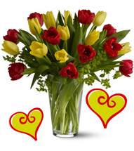 Cupids Bow Tulip Bouquet for Valentines Day by Enchanted Florist Pasadena TX. Have Cupid deliver this heartfelt bouquet of red and yellow tulips this holiday season. Long lasting tulips are a wonderful option when you don't want to send the traditional red roses. RM943