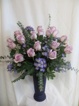 Two dozen beautiful purple roses will surely impress her! WIncludes this high quality upgrade purple vase she can use over and over. A must for the purple lover in you life. We deliver daily to Clear Lake TX and surrounding areas. RM 365
