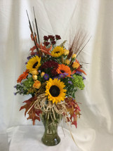 Majestic Harvest Fall Flower Bouquet from Enchanted Florist in Pasadena TX. This large beautiful fall bouquet is perfect for any office or home an includes bright yellow sunflowers, orange gerbera daisies, orange lilies, spray roses, poms, and more. RM210