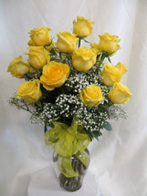 You Are My Sunshine Two Dozen Yellow Roses by Enchanted Florist Pasadena TX. This show stopping bouquets of our lush and romantic yellow Ecuadorian roses comes complete with greens and a bow and is hand arranged by our premier floral designers for delivery in the Houston Medical Center and surrounding areas.  RM370