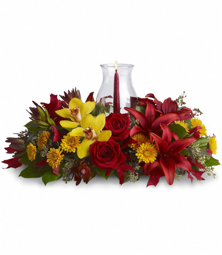 Glow of Gratitude Centerpiece from Enchanted Florist Pasadena TX. Fall flowers perfect for your family dinner table. T178-1