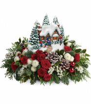 "Thomas Kinkade's Country Christmas Homecoming from Enchanted Florist Pasadena TX.   This special arrangement of red spray roses, white button spray chrysanthemums and white sinuata statice is accented with noble fir, flat cedar and variegated holly. Delivered with a Thomas Kinkade Country Christmas Homecoming keepsake. Approximately 16"" W x 10"" H 15X200"