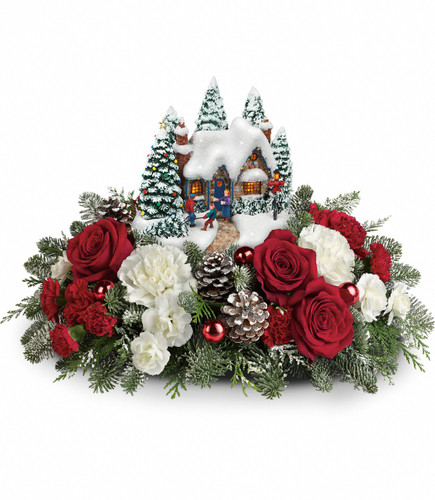 "Thomas Kinkade's Home Sweet Holidays from Enchanted Florist Pasadena TX.   This festive bouquet includes red roses, red carnations, white carnations, red miniature carnations, white miniature carnations, flat cedar, noble fir and seasonal accents. Delivered with a Kinkade Country Christmas Homecoming keepsake. Approximately 16"" W x 10"" H. 15X205"