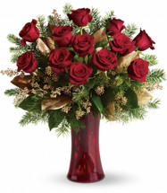 A Christmas Dozen Red Roses from Enchanted Florist Pasadena TX. Dazzling and delightful. A dozen red roses make a dashing holiday gift, especially when they are arranged with brilliant holiday touches and delivered in a ruby red vase. 115-2