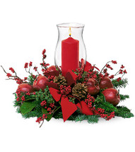 Hurricane Pillar Christmas Centerpiece from Enchanted Florist Pasadena TX. What better way to light up wintry hearts than with a gorgeous candle set in a hurricane globe? A decorator's delight. TF83-1