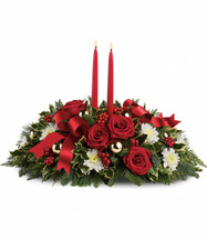 Holiday Shimmer Christmas Centerpiece with Candles from Enchanted Florist Pasadena TX. Make the season bright - and their table a delight - with the glowing tapers, radiant red roses and fresh Christmas greens of this stunning seasonal centerpiece. TWR12-5