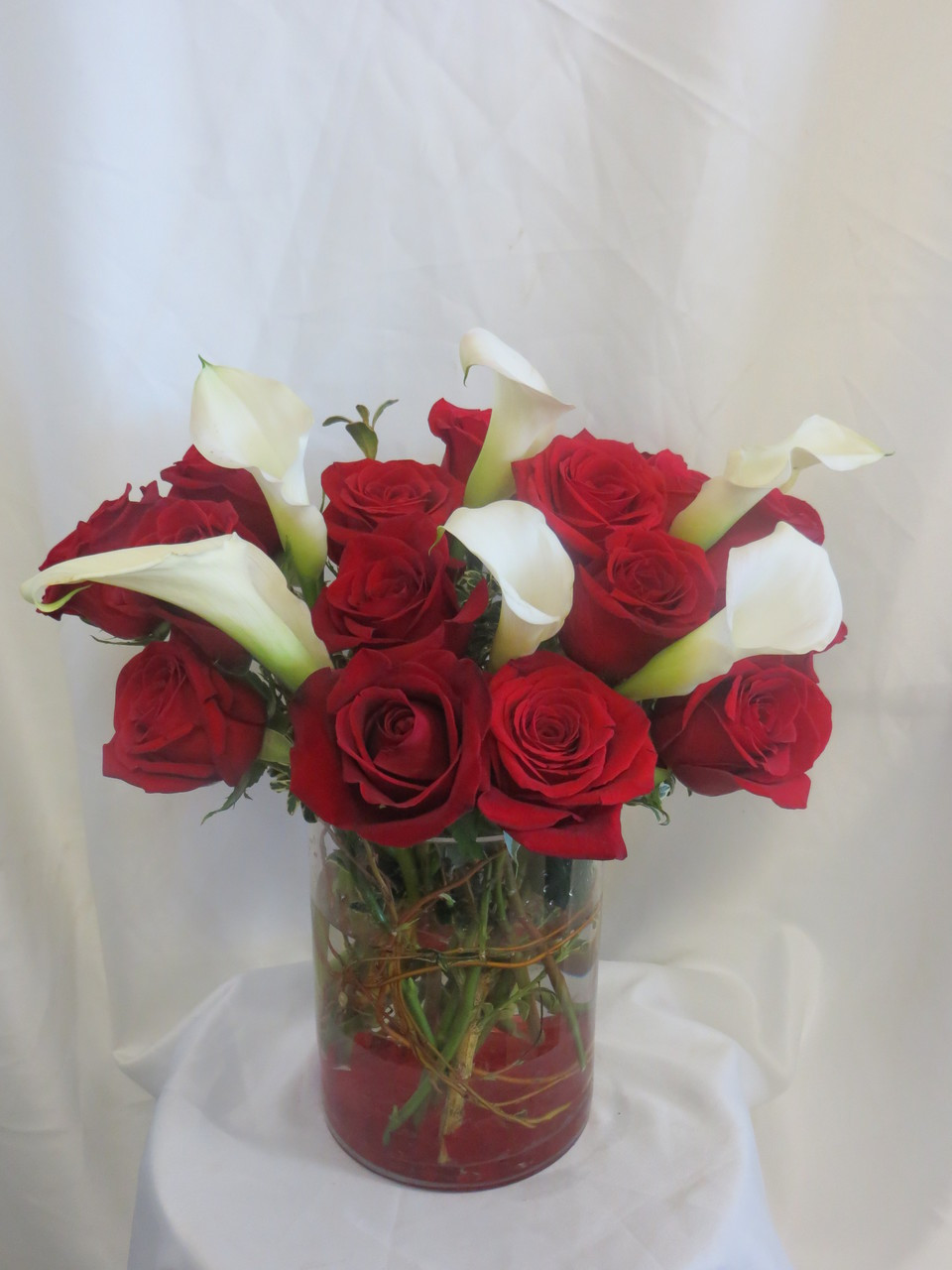 Embrace this luscious bouqet of red roses and calla lilies forever love flower bouquet by enchanted florist pasadena tx she will run to your embrace izmirmasajfo