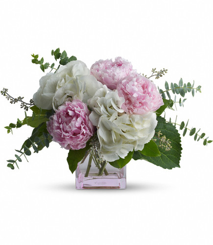 Pretty in Peony by Enchanted Florist. These pretty pink peonies must feel like they've landed in paradise. And perhaps they have, joined as they are by dazzling hydrangea blooms and greens. A beautiful Mother's Day bouquet. RM811