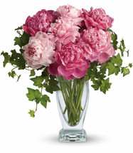 Perfectly Pink Peonies by Enchanted Florist. It's no wonder that the peony has been favored by First Ladies, famous ladies, and probably by a lady you know! They're so gorgeous and so pretty in pink. The big blossoms create a ripple effect of beauty wherever they are. RM812