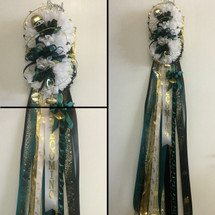 The Double Homecoming Mum from Enchanted Florist includes a double mum flower, trinkets, and decoration in the school colors of your choice. Colors pictured are for Memorial High School. HMC103