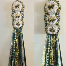 The Triple Homecoming Mum from Enchanted Florist includes a triple mum flower, trinkets, metallic chain, the Military braid, a mini Box braid, and the Loopty braid in the school colors of your choice. HMC112