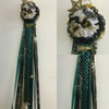The Premium Memorial High School Mum from Enchanted Florist includes a single mum flower, trinkets, chains, and Texas Checkerboard braid in Memorial High School colors, but can be created in the school colors of your choice. HMC108