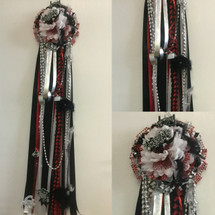 The Clear Brook Homecoming Mum from Enchanted Florist includes a single mum flower, trinkets, chains, and the Military braid in Clear Brook High School colors, but can be created in the school colors of your choice.