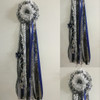 The Clear Springs High School Homecoming Mum from Enchanted Florist can be designed in any color for any school. It includes a single mum flower, trinkets, a chain, and a Military braid as shown. Two names are also included in the price.  HMC118