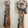 The Dobie High School Homecoming Mum from Enchanted Florist can be designed in any color for any school. It includes a single mum flower, trinkets, a chain, and a Military braid as shown.  HMC119