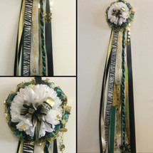 The Zebra Theme Homecoming Mum from Enchanted Florist can be designed in any color for any school. It includes a single mum flower, trinkets, a chain, and a spiral braid as shown.