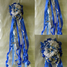 The Deluxe Sam Rayburn High School Homecoming Mum from Enchanted Florist can be designed in any color for any school. It includes a single mum flower and trinkets as shown.  All our mums come with a bell, 2 names, and what is shown in the picture.  HMC125