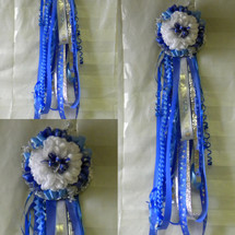 The Sam Rayburn High School Homecoming Mum with Braid from Enchanted Florist can be designed in any color for any school. It includes a single mum flower, trinkets, a chain, and a Military braid as shown. Plus all our mums come with a bell and 2 names. HMC126