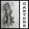 The Senior Homecoming Garter from Enchanted Florist includes a single garter flower, trinkets, metallic chain, the Military braid and garter band in the school colors of your choice.  HMC133