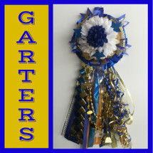 The Milby High School Homecoming Garter from Enchanted Florist includes a single garter flower, trinkets, metallic chain, the Diamond braid, and garter band in the school colors of your choice.  HMC138